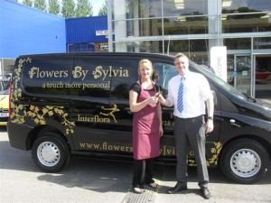 Sylvia Recieving the key's to another van from Aidan Corrigan at Donnelly Bros Enniskillen